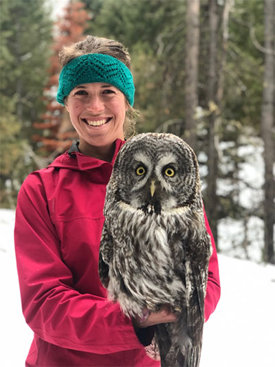 Image of Katherine Gura posing with a Great Gray Owl